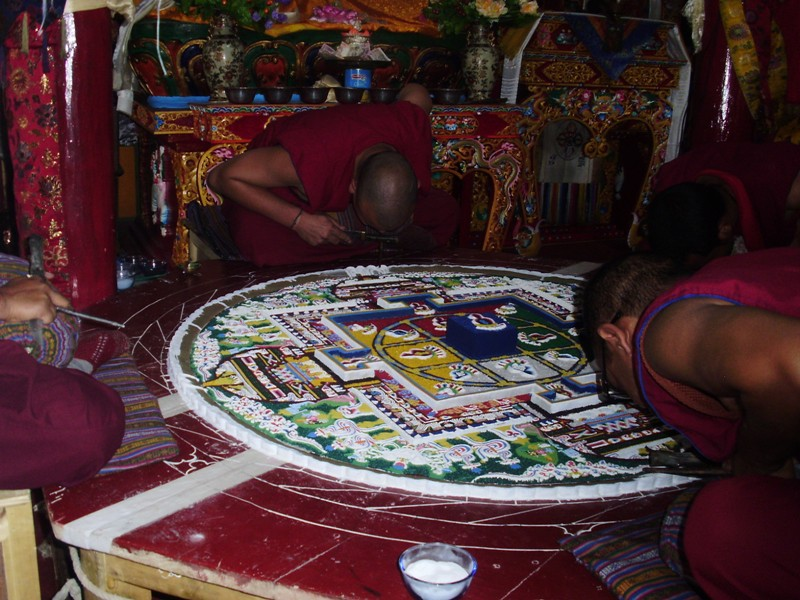 monks working on sand manala
